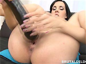 Elis feeds her vagina a fierce fake penis until she creams