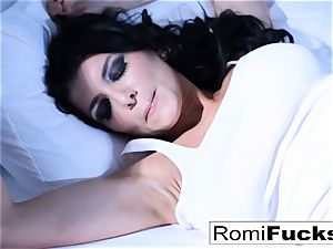 Solo fun on the sofa with the huge-boobed superstar Romi Rain