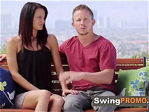 girl/girl swingers put on a kissing display
