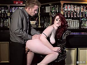 redhead Jaye Rose uses her milk cans to get the job