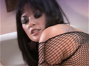 Kaylani Lei stretches her mouth-watering slits and enjoys the hard pole in her
