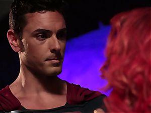 Britney Amber inhales off a kinky superhero
