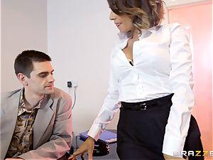Workmates watch as Cara Saint-Germain screws in the office