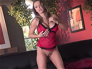 Jenna Presley takes it off slowly to flash off her immense udders and smoking assets